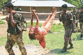 In West Bengal the security forces carried dead body of a tribal girl in such ghastly manner